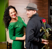Man surprising girlfriend with flower Royalty Free Stock Photo
