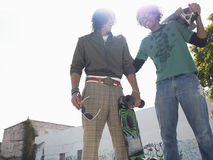 Cheerful Young Men With Skateboarders Stock Photo