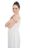 Cheerful young model in white dress posing Royalty Free Stock Photos