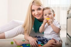 Cheerful young mom is playing with her baby Royalty Free Stock Photography