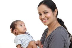 Cheerful young mother holding baby boy. Close up of cheerful young mother holding baby boy Stock Photo