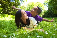 Cheerful young mother with son Stock Image