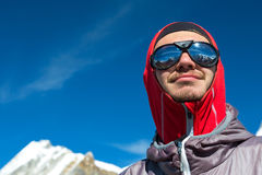 Cheerful young Mountain Climber in Sunglasses and protective Clothing Royalty Free Stock Photography