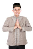 Cheerful young muslim man. Portrait of cheerful young muslim man on white background Royalty Free Stock Image