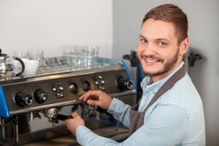 Cheerful young owner of cafeteria is working Royalty Free Stock Photo