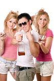 Cheerful young people with a bottle Royalty Free Stock Photography