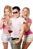 Cheerful young people with a bottle of whiskey Stock Photography