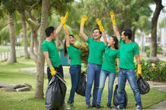 Cheerful young people collected garbage Royalty Free Stock Photos