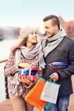 Cheerful young people doing Christmas shopping Stock Photo