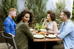 Cheerful young people have lunch in the courtyard and have a fun royalty free stock photos
