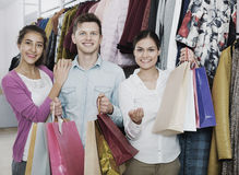 Cheerful young people with purchases Royalty Free Stock Photography