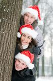 Cheerful young people in rad hats Stock Photo