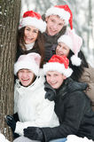 Cheerful young people in rad hats Royalty Free Stock Photography