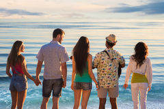 Cheerful young people rest on the nature. Stock Photos