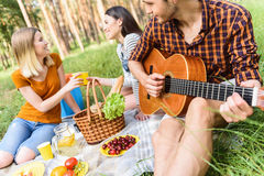Cheerful young people resting in forest Stock Photography