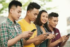 Cheerful young people with smartphones Stock Image