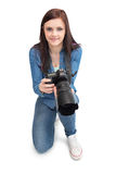 Cheerful young photographer posing Stock Photo