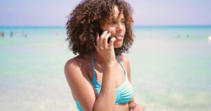 Cheerful woman talking on phone at seaside stock video footage