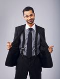 Cheerful Young Professional Holding Open His Coat Royalty Free Stock Photography