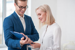 Cheerful young realtor is working with client Stock Photo