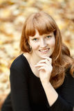Cheerful young red haired girl stock photos