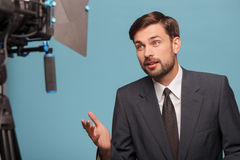 Cheerful young reporter is telling some news Royalty Free Stock Photography