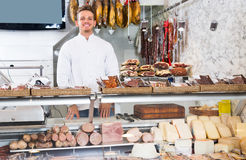 Cheerful young seller at butcher market Stock Image