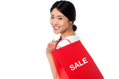 Cheerful young shopaholic girl Royalty Free Stock Image