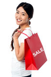Cheerful young shopaholic girl Royalty Free Stock Images