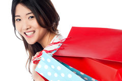 Cheerful young shopaholic girl Stock Photography