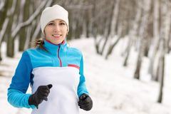 Cheerful young sport woman at winter outdoor activity Stock Photos