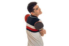 Cheerful young sports man playing ping-pong isolated on white background Royalty Free Stock Images