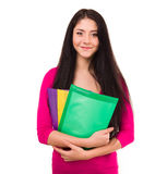 Cheerful young student with exercise books isolated on white background. Stock Images