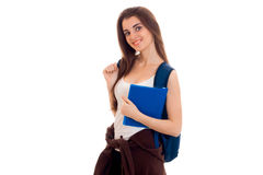 Cheerful young student girl with backpack and books smiling on camera isolated on white background. student years Stock Image