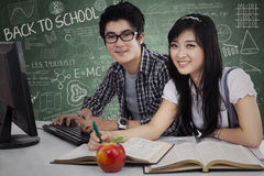 Cheerful young students in class 1 Stock Images