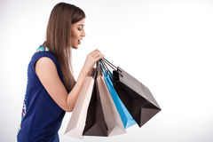 Cheerful young styled girl is a crazy shopaholic Stock Photo