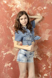 Cheerful young teen girl in denim shorts Royalty Free Stock Images