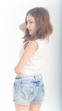 Cheerful young teen girl in denim shorts Stock Image