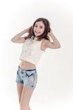 Cheerful young teen girl in denim shorts. Cheerful young teen girl in denim jeans shorts Stock Image