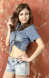 Cheerful young teen girl in denim shorts. Cheerful young teen girl in denim jeans shorts Royalty Free Stock Photo
