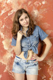 Cheerful young teen girl in denim shorts Royalty Free Stock Photo