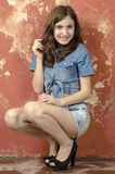 Cheerful young teen girl in denim shorts. Cheerful young teen girl in denim jeans shorts Royalty Free Stock Image