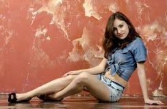 Cheerful young teen girl in denim shorts. Cheerful young teen girl in denim jeans shorts Stock Photography