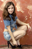 Cheerful young teen girl in denim shorts. Cheerful young teen girl in denim jeans shorts Royalty Free Stock Photography