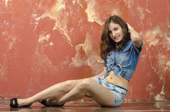 Cheerful young teen girl in denim shorts. Cheerful young teen girl in denim jeans shorts Royalty Free Stock Images