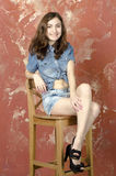 Cheerful young teen girl in denim shorts Royalty Free Stock Image