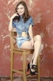 Cheerful young teen girl in denim shorts. Cheerful young teen girl in denim jeans shorts Stock Photo