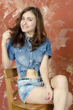 Cheerful young teen girl in denim shorts Stock Photos
