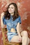 Cheerful young teen girl in denim shorts. Cheerful young teen girl in denim jeans shorts Stock Photos