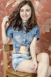 Cheerful young teen girl in denim shorts. Cheerful young teen girl in denim jeans shorts Royalty Free Stock Photos